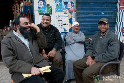 Group of Egyptian men chatting on the sidewalk in Alexandria, Egypt.