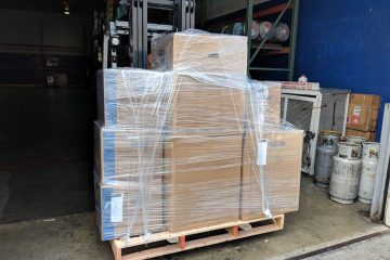 Logistics checklist for moving to a new country - moving boxes at the shipping port