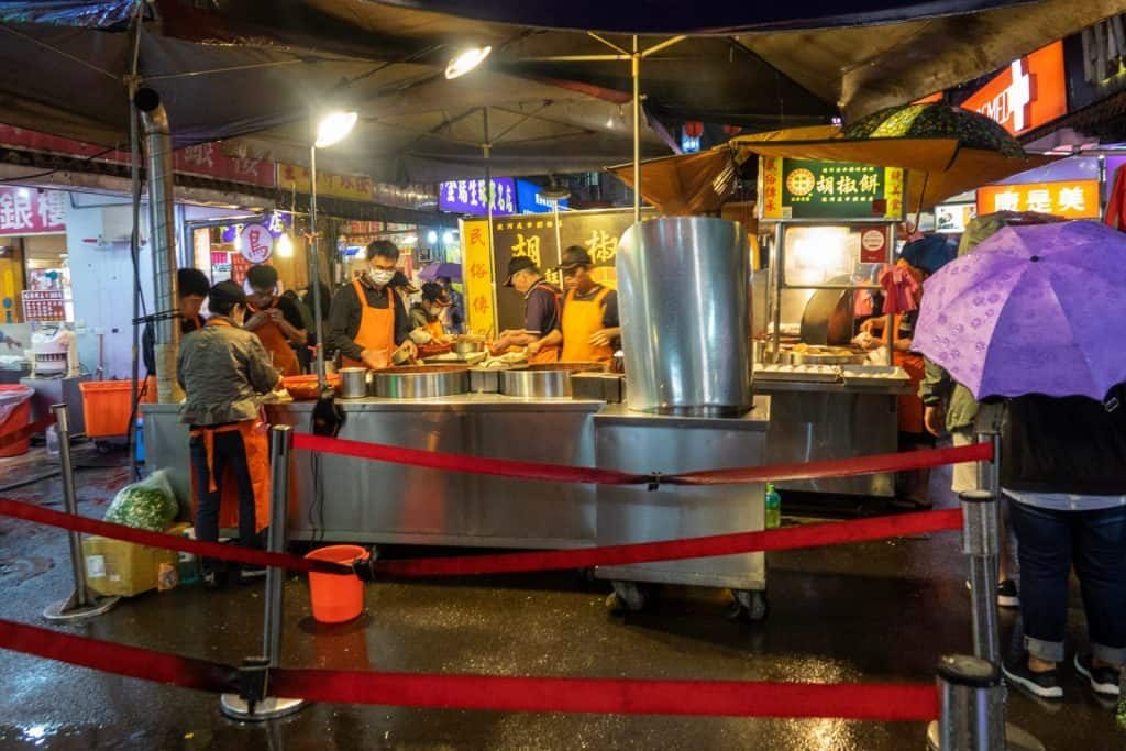A long line outside the pepper buns stand in a Taiwan night market is a great sign this place will have great food.