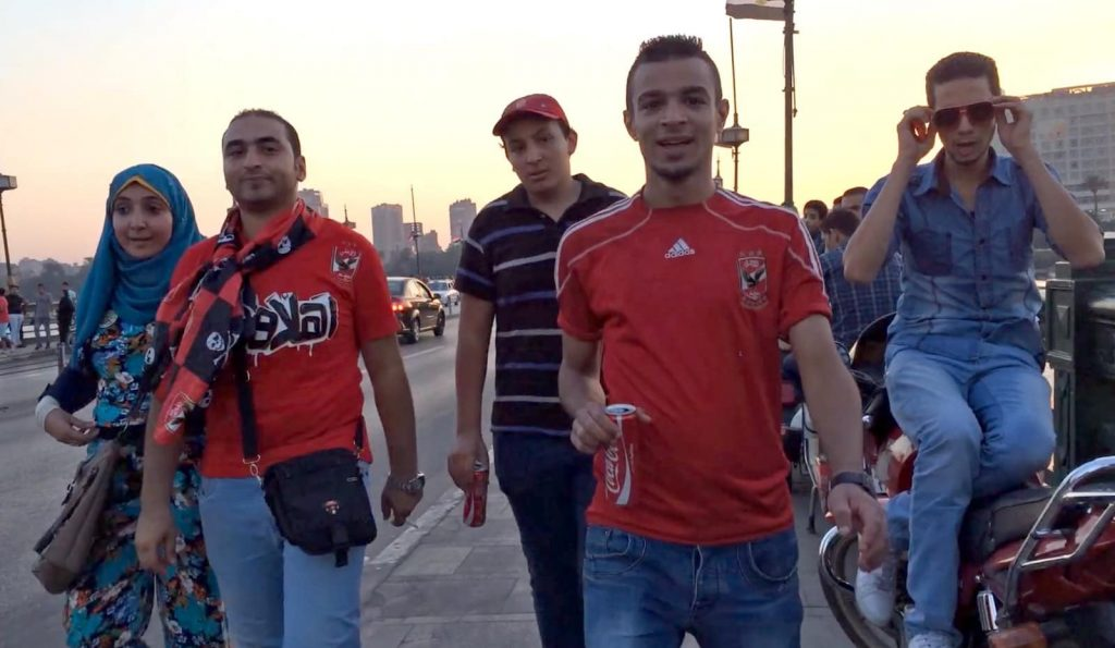 Discover Discomfort - Is Egypt Safe for travel? Looking at this photo of four men gawking at a woman, Egypt is not as safe for women as it is for men.