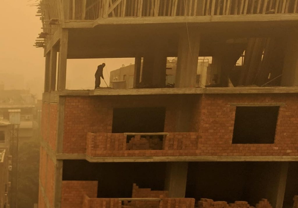 Discover Discomfort - Living in Cairo - Guy walking in Sandstorm