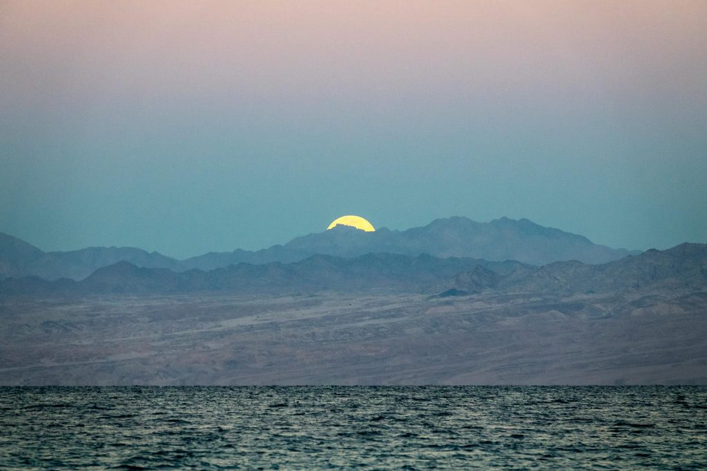 The super moon setting over Saudi Arabia, seen from from Nuweiba, Sinai.