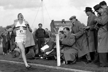 Roger Bannister running the 4 minute mile. How fast can you run it?