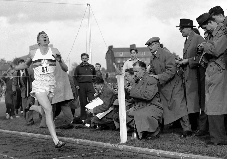Roger Bannister, the first person to ever break the 4 minute mile. How fast should you be able to run a mile?