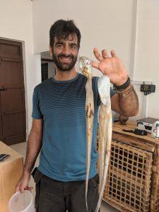 Being a mzungu in Zanzibar - receiving a gift of squid from village friends.