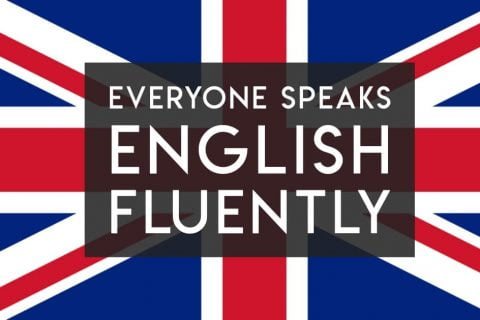 """British flag with text """"everyone speaks english fluently"""" on it"""