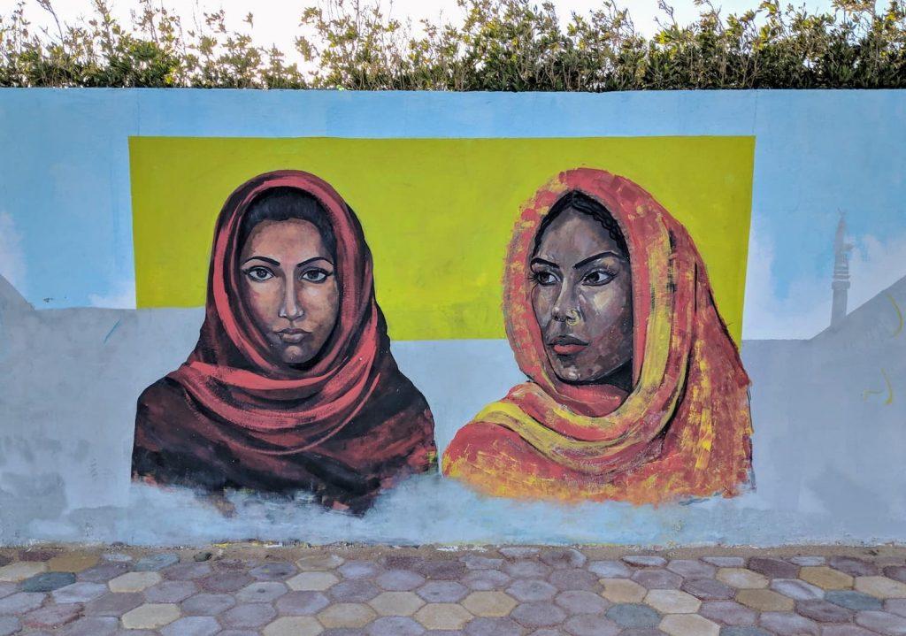 Two women in shawls/hijab (Islamic Headdress). Graffiti on a wall in Dahab, Egypt.