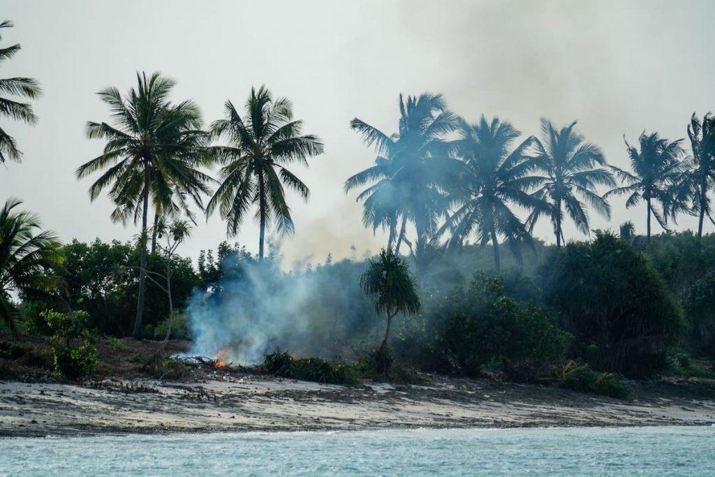 A plastic and waste trash fire in Zanzibar, Tanzania