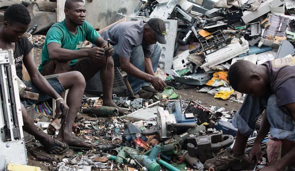 E-waste sorters at a tip/recycling center at Accra, Ghana