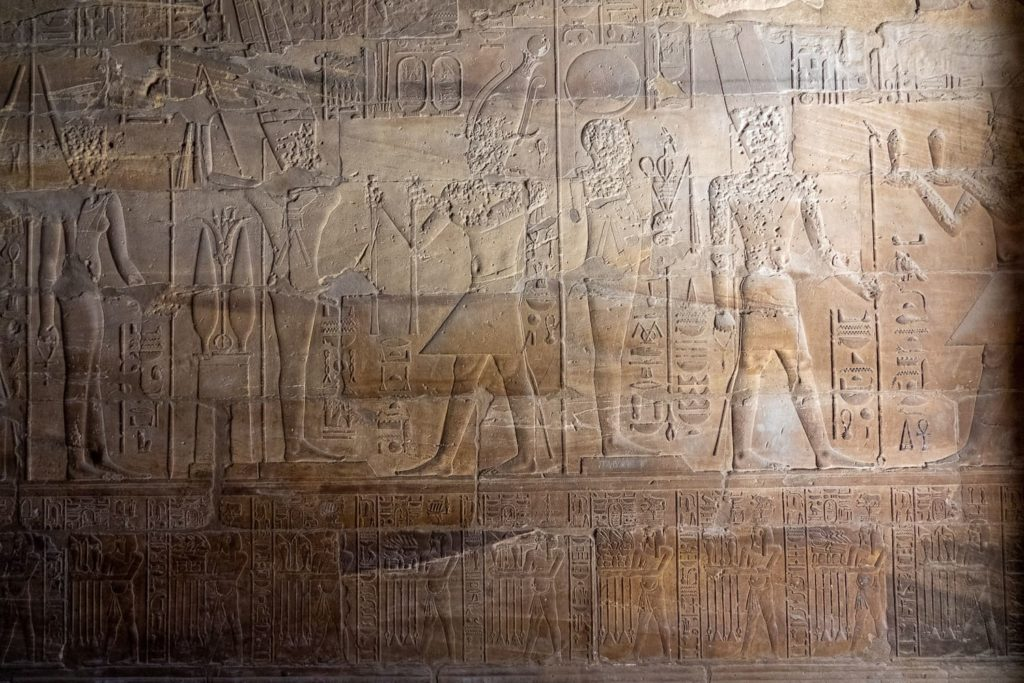 A relief of hieroglyphs and pharoahs in a temple in Luxor, Egypt