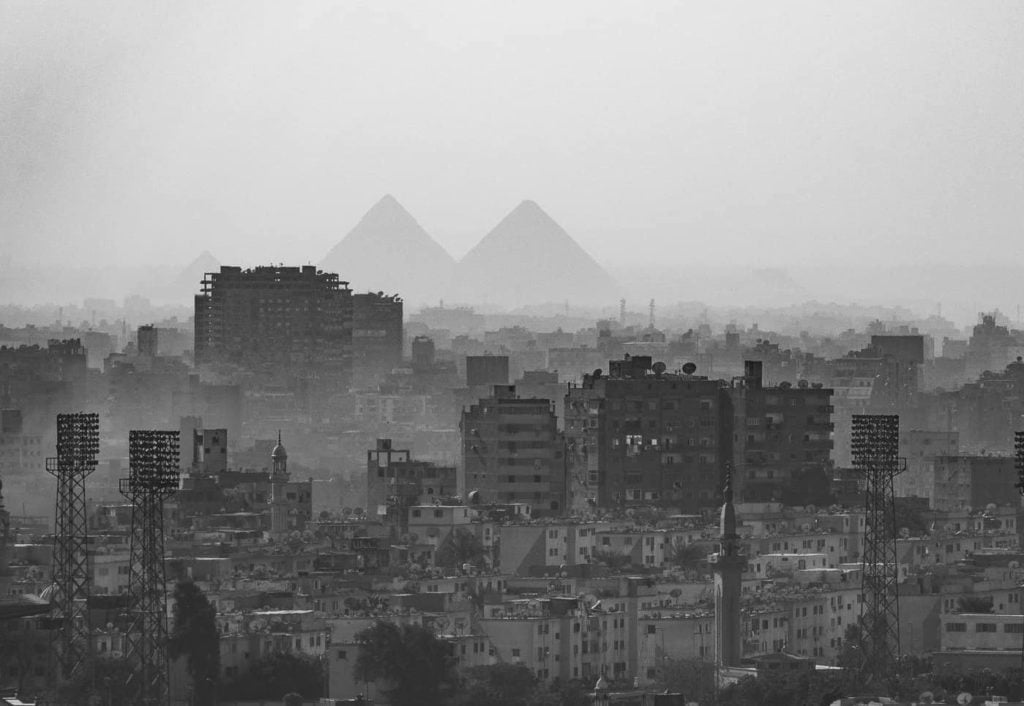 Pyramids behind Cairo in Egypt Black and white