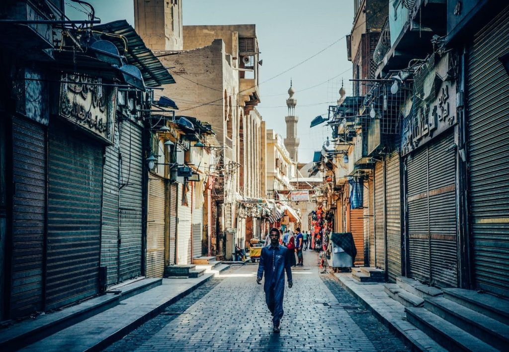 A man walking in Cairo, Egypt, in the Islamic quarter