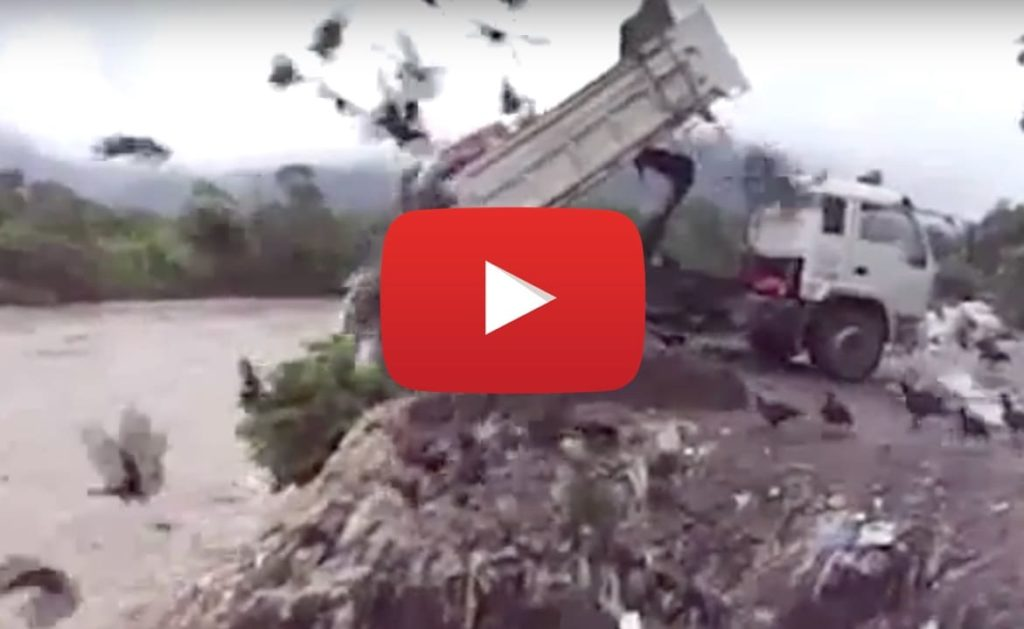 Demonstration of trash being dumped into the amazon in Peru