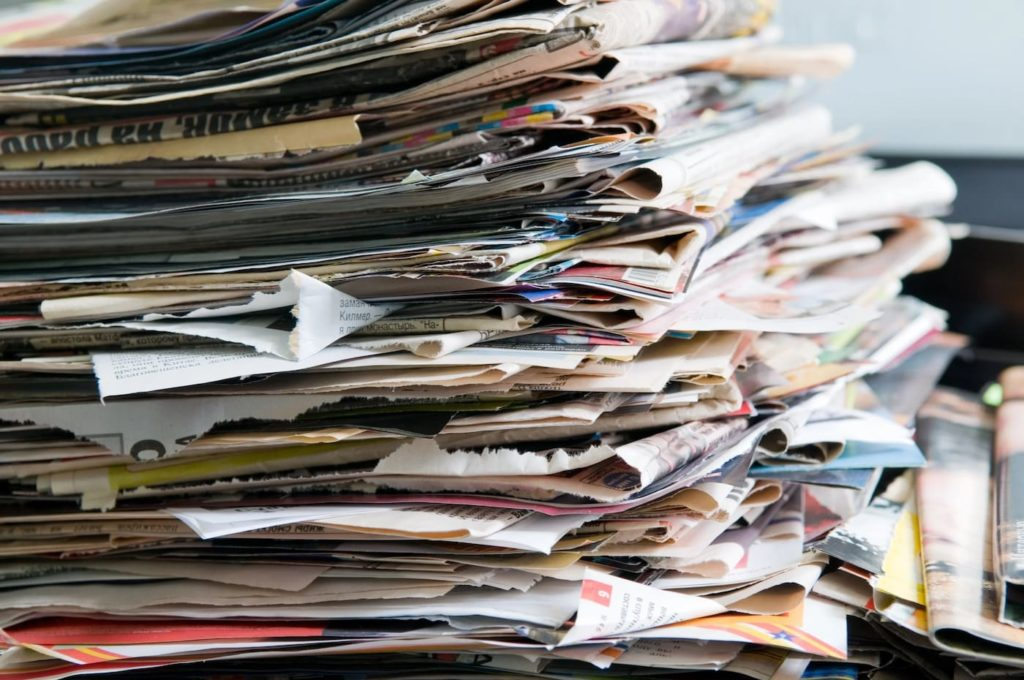a pile of resumes. one benefit having learned a new language is your resume stands out.