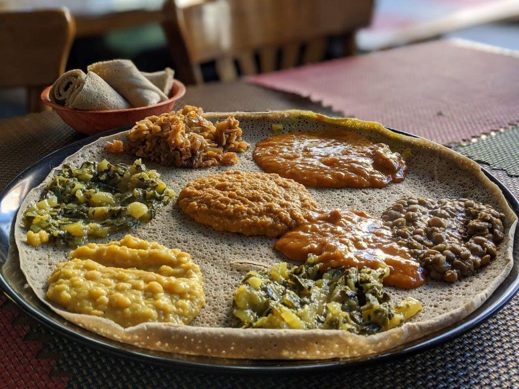 Injera with curries, ethiopian food in tel aviv