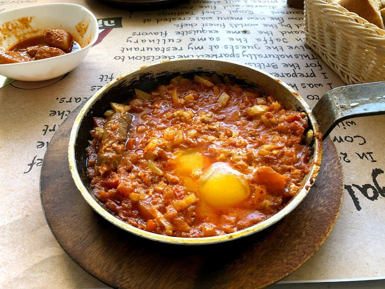Shakshuka - oven baked eggs in meat with spices and tomato