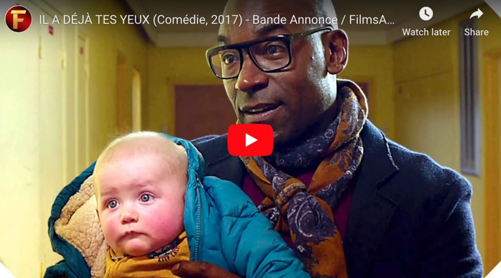 """Screen grab from the french film """"he even has your eyes"""", showing a white baby with a black man"""