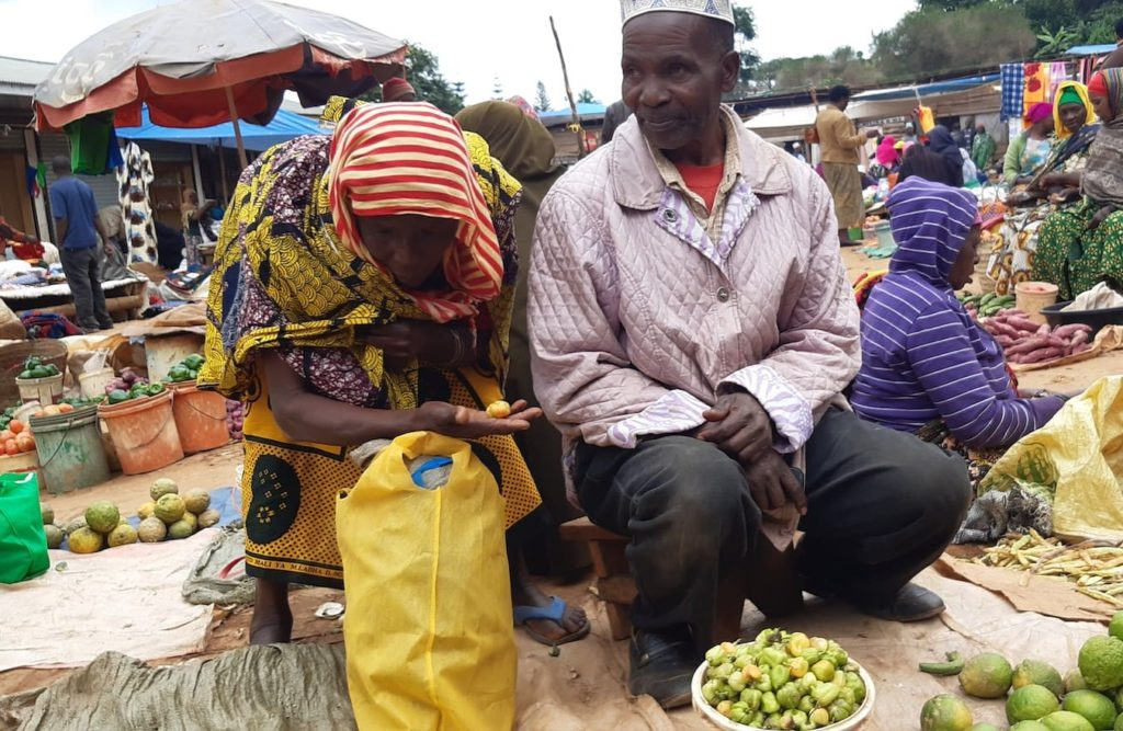 Elderly swahili-speaking people in a market in Tanzania