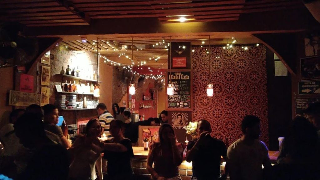 Dancing salsa in the bar malamaña in Cali, colombia — one of our favourite Cali salsa clubs