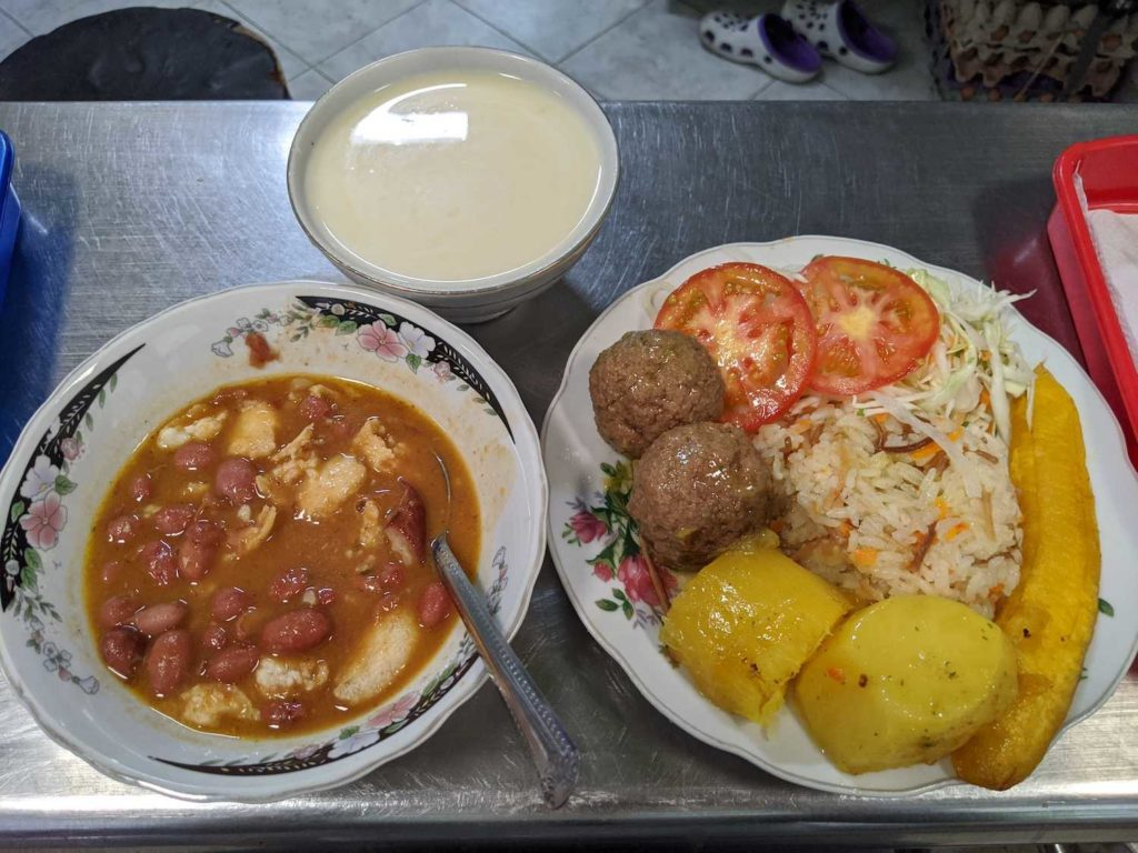 Menu del dia in Medellin, Colombia. Albondigas (meatballs), and a bean soup (frijoles). And a bowl of claro (corn with milk)