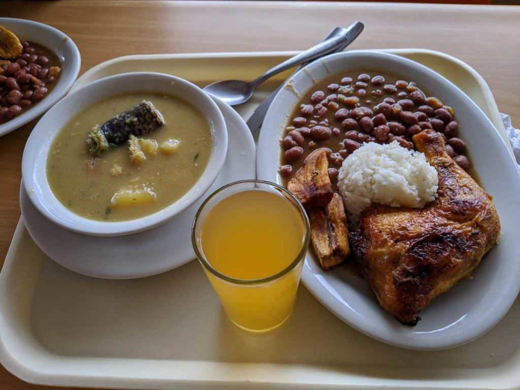 Menu del dia in Colombia. Chicken, rice, banana, beans, soup.