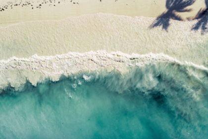 Overhead view of a beach in Zanzibar, where arabic words in Swahili are common