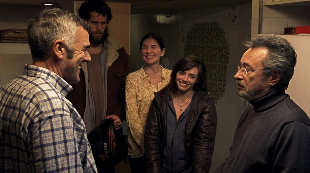 """Screen grab from """"El Ciudadano Ilustre"""", people talking to each other in spanish"""