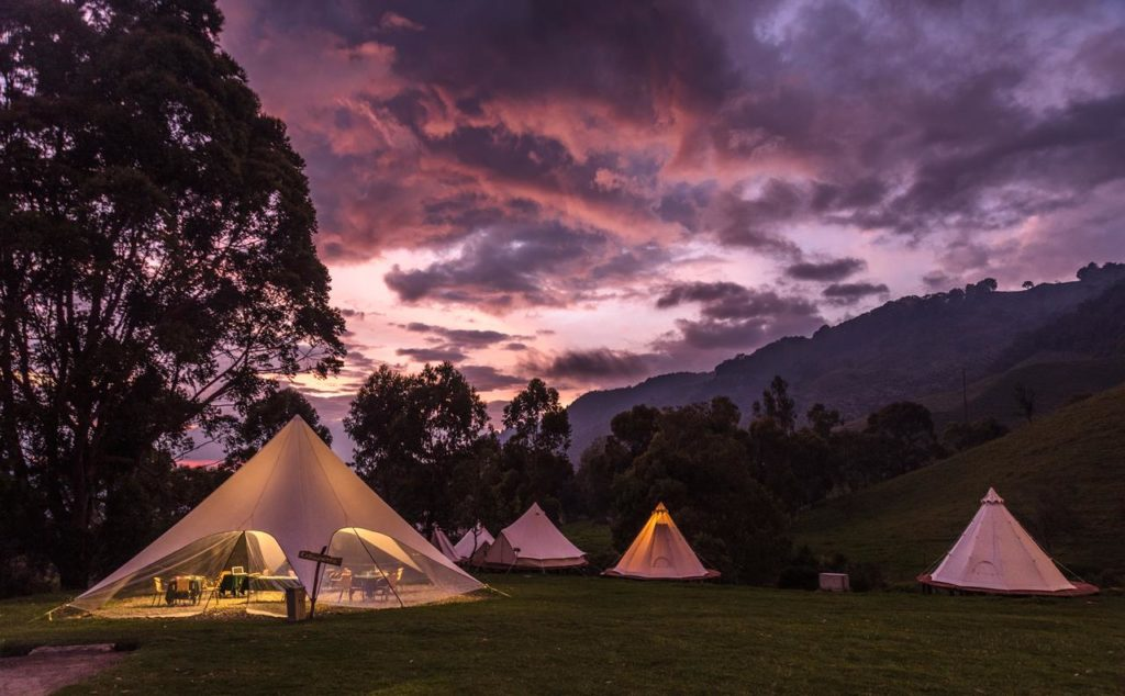Glamping Lumbre Tents camping at sunset purple clouds