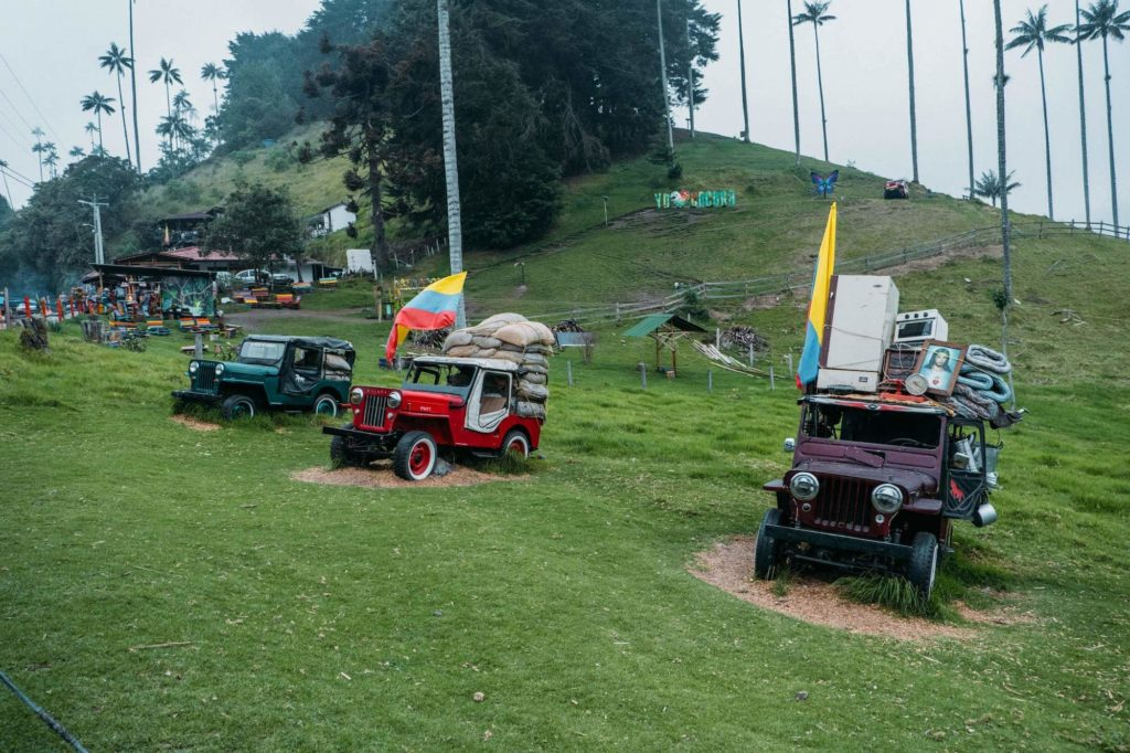 Jeeps / Willys on grass in Valle de Cocora with Colombian flag