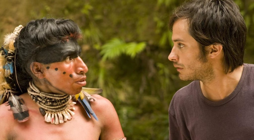 Screen grab of native american Quechua man talking to producer of film in Tambien la Lluvia, a spanish language movie from argentina