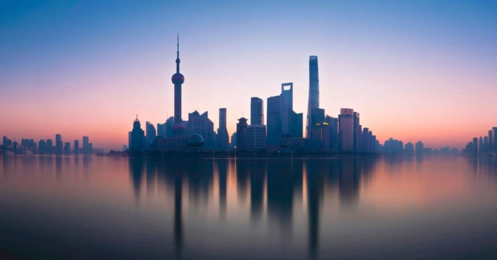 Shanghai at dawn with pink and blue skyline, where you'd be expected to say good morning in chinese