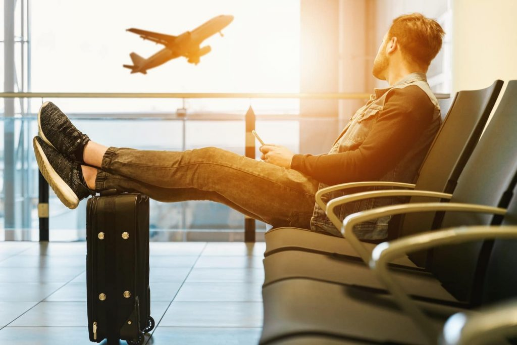 Travel gifts for men - luggage, a smartphone, and shoes