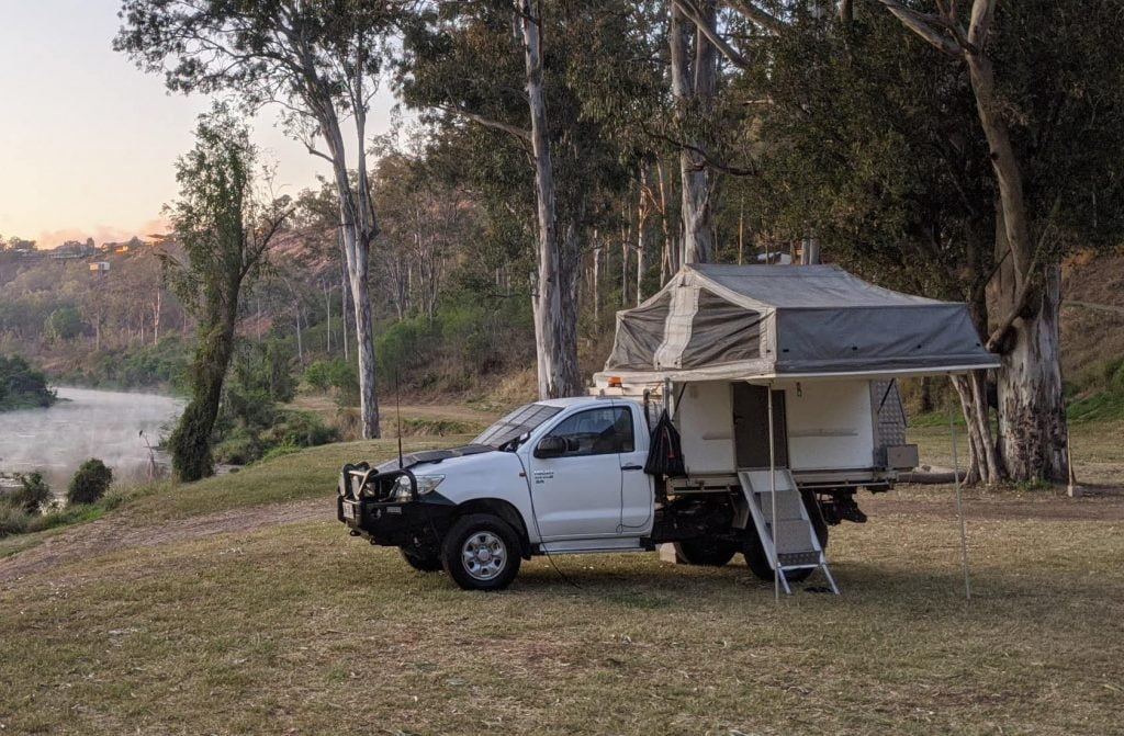 Toyota hilux 4x4 trayon camper set up next to river