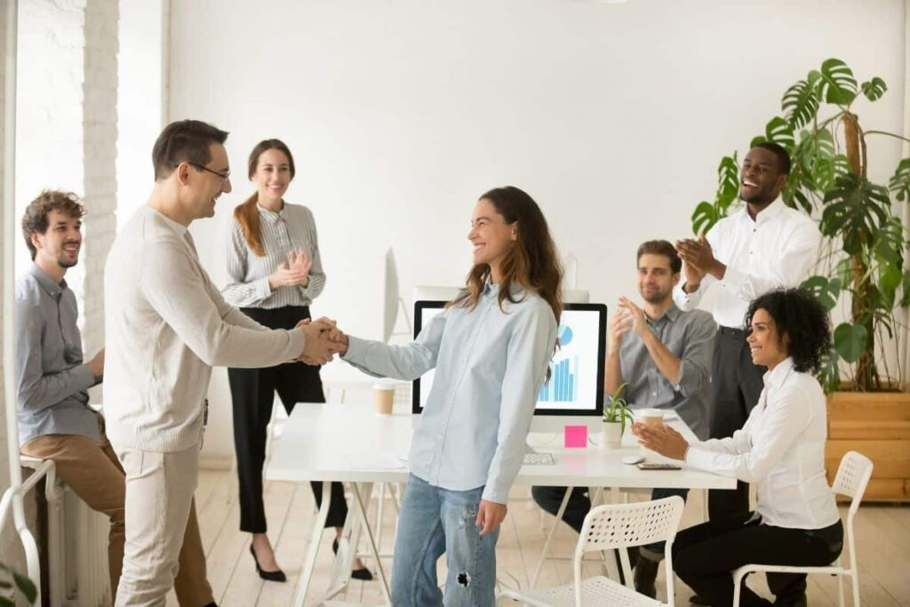 Congratulations in German group coworkers clapping